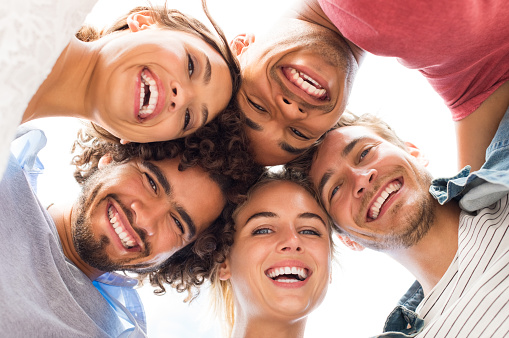 A group of people smiling after receiving teeth whitening and teeth bleaching at Long Island Smile in Williston Park, NY